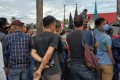 """Crowds gather to demonstrate against Chinese workers in Sulawesi, Indonesia. They are also worried the workers may """"expose"""" the local community to Covid-19. Photo: Sulkarnain"""