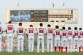 Hiroshima Toyo Carp players pray for atomic bomb victims before a game in Hiroshima on August 6, 2015. The city suffered the world's first atomic bombing, but for locals, baseball helped boost morale on the road to recovery. Photo: AFP via Getty Images