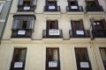 """Signs saying """"For Sale"""" hang on the balconies of a flat block in central Madrid. Spain ranks highly as a relocation choice among homebuyers surveyed by Knight Frank. Photo: Reuters"""