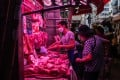 Customers wearing protective face masks browse red meat at a wet market in the Sham Shui Po district in Hong Kong, in July. Photo: Bloomberg