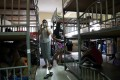 Foreign domestic helpers share a dormitory room at the Technic Employment Service Centre in Causeway Bay. Health officials this week discovered an Indonesian woman with Covid-19 had lived in at least three group settings recently. Photo: Sam Tsang