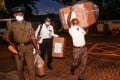 Election officials transport ballot boxes to the main counting centre amid legislative elections in Sri Lanka on Thursday. Photo: dpa