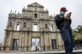 A man checks his phone in front of the Ruins of Saint Paul's in Macau. The city recorded fewer than 50 confirmed cases of Covid-19 and no fatalities as of August 7. Photo: Winson Wong