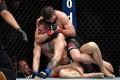 Khabib Nurmagomedov choks Conor McGregor during UFC 229. Photo: Stephen R. Sylvanie-USA TODAY Sports