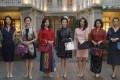 A scene from the popular Chinese TV drama series Nothing But Thirty in which a character (left) has her Chanel handbag cropped from a group picture by her fellow socialites, who all tote Hermès Birkin bags.