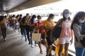 Foreign domestic helpers queue up to transfer money at World Wide House in Central earlier this month. Photo: Dickson Lee