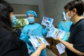 Medical staff give out testing kits to residents in Ping Shek Estate in Kwun Tong. Photo: Dickson Lee