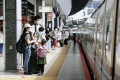 Passengers wait to get on a shinkansen bullet train at JR Tokyo Station on Saturday, as fewer people head to their hometowns over the summer holiday period. Photo: Kyodo