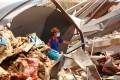 A member of Turkish rescue team works at the site of Tuesday's blast at Beirut's port area on Friday. Photo: Reuters