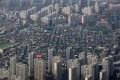 An aerial view of residential apartment buildings and houses in Seoul, South Korea. Photo: Bloomberg