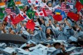 Graduates from many countries wave flags during a commencement ceremony at Columbia University, New York, in May 2018. Part of the international student experience is learning to accept different cultures, a lesson that world leaders would do well to learn. Photo: Xinhua