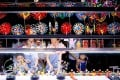 Tourists buy souvenirs at a shop in the city of Qingdao, in east China's Shandong province, on July 25. President Xi Jinping recently said the country would pursue a new development plan, focusing on its domestic market rather than an export-led growth model. Photo: Xinhua