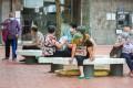 Elderly residents sit outside at Kai Yip Estate in Kowloon Bay. Photo: Sam Tsang