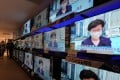 Multiple screens show Hong Kong Chief Executive Carrie Lam Cheng Yuet-ngor announcing the postponement of the city's Legislative Council elections. Photo: Felix Wong