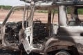 The burnt-out remains of a 4x4 vehicle with bullet holes in the side. Photo: AFP