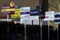 Property agents' sales and to let signs are seen in London. London is epcted to see a revival in overseas buying interest after the pandemic ends. Photo: Reuters