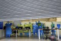 Medical and police personnel in protective suits are seen inside a makeshift hospital in Wuhan as it closes following the discharge of its last batch of coronavirus patients on March 9. Photo: Reuters