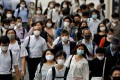 Commuters wear protective face masks in Tokyo on July 30. Japan might be a close ally of the United States but Japanese investors, who have historically been big buyers of Treasuries, are not charities. Photo: Reuters