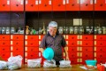 Herbalist Dr Zhang prepares a concoction of Chinese herbs at Hoaping Clinic in Northbridge, Perth, Western Australia. Northbridge is like stepping through a portal into China itself. Photo: Lynn Gail