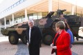 Australian Prime Minister Scott Morrison and Defence Minister Linda Reynolds walk past an armoured combat vehicle as they arrive at the Australian Defence Force Academy in Canberra on July 1. Morrison has pledged to spend billions on defence over the next 10 years in a move widely seen as aimed at countering China's growing presence in the region. Photo: EPA