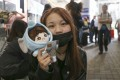 Some K-pop fan-girls fear ridicule from friends and family for having 'lowbrow tastes'. This 14-year-old fan spent the night at Hong Kong International Airport to catch a glimpse of BTS. Photo: Rachel Cheung