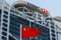 A Chinese national flag flies in front of HSBC headquarters in Hong Kong. Photo: Reuters