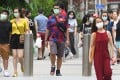 People seen in face masks at Orchard Road in Singapore. File photo: AFP