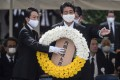 Japanese Prime Minister Shinzo Abe lays a wreath during a ceremony marking the 75th anniversary of the atomic bombing of Nagasaki. Photo: AFP