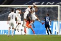PSG's Eric Maxim Choupo-Moting (second right) scores during the Uefa Champions League quarter final against Atalanta. Photo: EPA