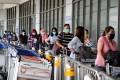 Passengers queue up for temperature checks before entering Manila's Ninoy Aquino International Airport on August 3. Photo: EPA