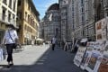 Picture sellers on another quiet day outside the Duomo di Firenze, in Florence, Italy. Photo: Red Door News
