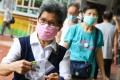 Health department staff give out Covid-19 testing packs on an estate in Kowloon. Photo: Dickson Lee
