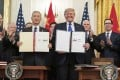 Chinese Vice-Premier Liu He (left) and US President Donald Trump hold up signed copies of the phase one trade deal between their countries in January. Liu is expected to hold a video conference this week with the US side to discuss the deal. Photo: DPA