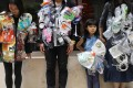 A child joins environmental activists wearing jackets made of plastic waste as they appeal for a plastic-free future to mark International Earth Day, in Wan Chai in April 2018. Photo: Sam Tsang