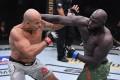 Jairzinho Rozenstruik punches Junior dos Santos in their heavyweight bout during UFC 252 UFC Apex on August 15, 2020 in Las Vegas, Nevada. Photos: Jeff Bottari/Zuffa LLC