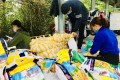 Volunteers from Vietnamese organisation Karma Waters Charitable Association organise food donations for the needy. Photo: Handout