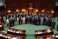 Pro-Beijing lawmakers pose for the customary group photo at the close of the 2016-2020 legislative term, in the Legislative Council chamber on July 17. For the first time since the 1997 handover, opposing lawmakers refused to come together for the ceremonial photo. All lawmakers may continue in office for an extra year, as the election was postponed due to Covid-19. Photo: Dickson Lee