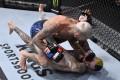 Marlon Vera punches Sean O'Malley in their bantamweight bout during UFC 252 at UFC Apex on August 15, 2020 in Las Vegas, Nevada. Photos: Jeff Bottari/Zuffa LLC