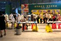 Medical workers wearing protective suits conduct nucleic testing outside the IBC Mall in Shenzhen after a worker was confirmed to have the coronavirus. Photo: Reuters