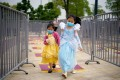 Children wearing face masks walk past social distancing markers to enter Shanghai Disneyland on May 11. China is the world's most populous country now, but research suggests its population could shrink by half by 2100. Photo: Reuters
