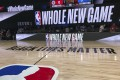 A basketball court at the ESPN Wide World of Sports complex showing the NBA's marketing motto for the restart of the season: 'Whole New Game'. Photo: AP