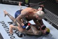 Marlon Vera punches Sean O'Malley in their bantamweight bout during UFC 252. Photo: Jeff Bottari/Zuffa LLC