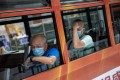 Tram passengers in protective face masks. Hong Kong is battling a third wave of Covid-19 infections. Photo: EPA-EFE