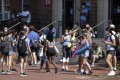 University of North Carolina students stand outside Woolen Gym on the Chapel Hill campus on Monday. Photo: The News & Observer via AP