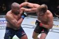 Daniel Cormier and Stipe Miocic trade blows in their UFC heavyweight championship bout at UFC 252. Photo: Jeff Bottari/Zuffa LLC