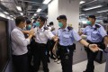 Apple Daily editor-in-chief Law Wai-kwong confronts police during their raid of the newspaper's offices in Tseung Kwan O. Photo: Handout