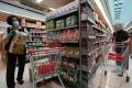 Staff and a customer at a Wellcome supermarket at Metro City in Tseung Kwan O earlier this week. Photo: Felix Wong