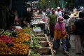People shop at a market in Jakarta. Indonesia's informal sector makes up between 60 and 70 per cent of the economy, and is where the country's most vulnerable make their living. Photo: Reuters