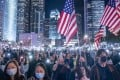 US flags are waved at a pro-democracy demonstration in Hong Kong on November 28. Photo: Justin Chin/Bloomberg