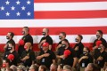 Supporters of US President Donald Trump stand for the national anthem before a campaign rally on August 18 in Yuma, Arizona. Trump is currently trailing his Democratic rival Joe Biden in the polls but it would be a mistake to write off his chances. His base is more passionate about him than Democrats are about Biden. Photo: Getty Images / AFP